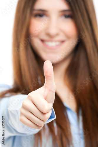 Beautiful businesswoman giving thumbs up