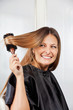 Woman Brushing Hair In Salon