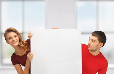 man and woman with big blank board
