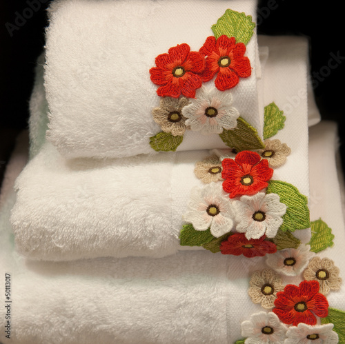 white, clean towel decorated by flowers