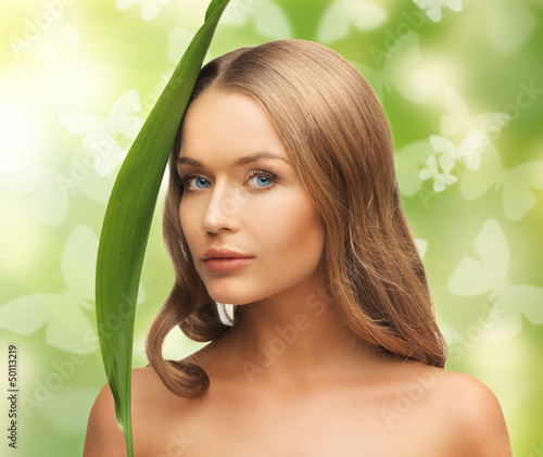woman with green leaf and butterflies