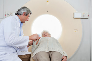 Radiologist Comforting Patient Before CT Scan