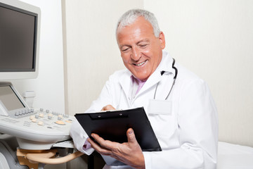 Radiologist Holding Clipboard