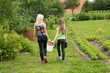 Mother and daughter walk home from the garden