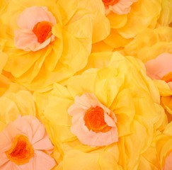 Handmade big yellow paper flowers background