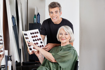 Client With Hairstylist Holding Color Catalog