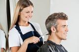 Hairdresser Cutting Customer's Hair