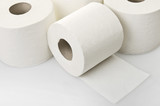 Rolls of toilet paper close up on white