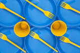 bright plastic disposable tableware, background