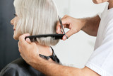 Hairstylist Measuring Hair Length Before Haircut poster