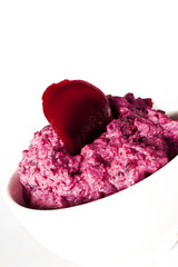 beetroot dip in a white bowl
