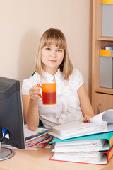 businesswoman reading documents and drinking tea