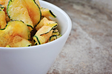 a bowl on zucchini chips