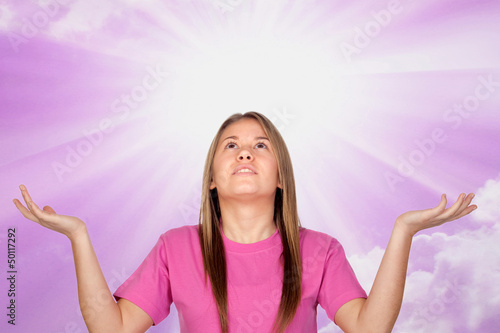 Adorable teen girl praying