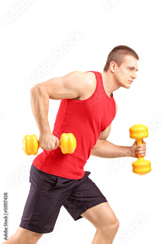 Muscular athletic man lifting weights