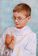 boy going to the first holy communion with a rosary