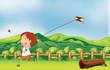 A boy flying his kite at the bridge