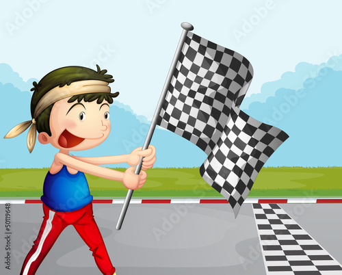 A young boy holding a checkered banner