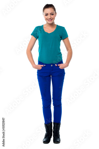 Pretty woman with hands in jeans pocket