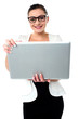 Bespectacled woman holding a laptop