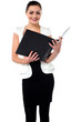 Female secretary reviewing companys file