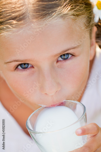 Healthy kid - lovely girl drinking fresh milk