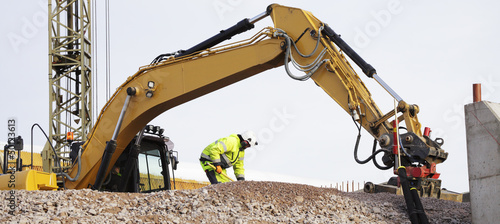 bulldozer and building workers in action
