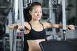 The girl is engaged in gym doing exercise strengthens the chest