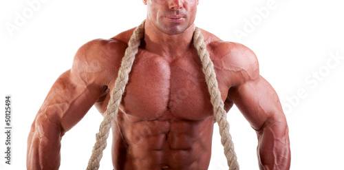 bodybuilder posing with rope