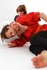 women fighting martial arts