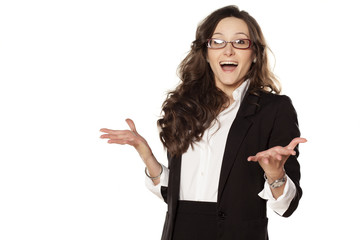 Smiling and surprised girl in glasses on white background