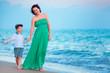 Mother and her little son enjoying beach