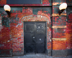 Exterior steel door on brick building exterior