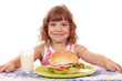 little girl with big sandwich and milk breakfast time