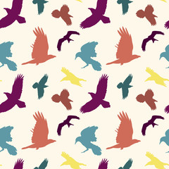 Colourful birds silhouettes seamless pattern