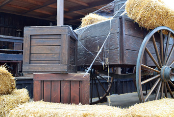 Old cart and wooden boxes in a barn