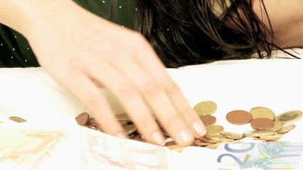 Woman counting money sad economical problems