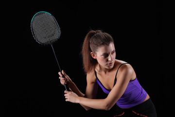 woman with badminton racket isolated on black