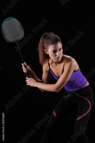 woman with badminton racket isolated on black