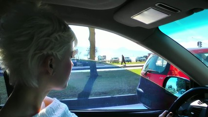 Woman is Driving in the City