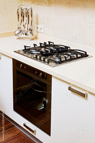 Part of modern  kitchen interior with gas-stove
