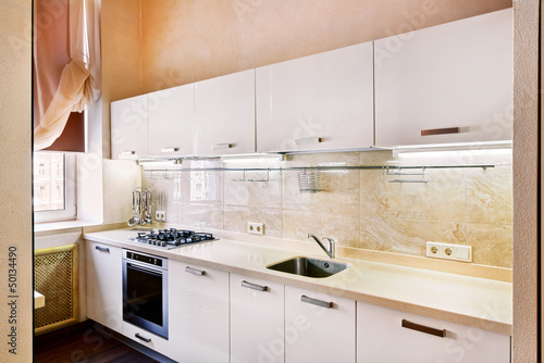 Modern  kitchen interior in beige tones