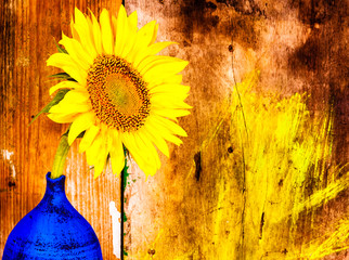 Sunflower on a blue vase with a wooden background