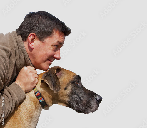 isolated rugged man with dog looking forward