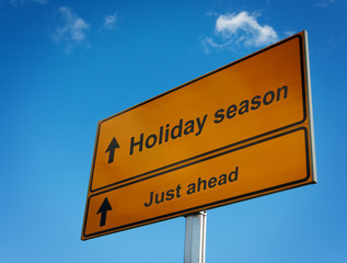 Holiday season road sign background sky.