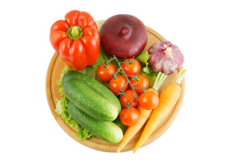 Vegetables on wooden cutting board isolated on white