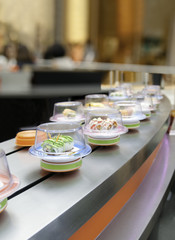 Sushi on conveyor