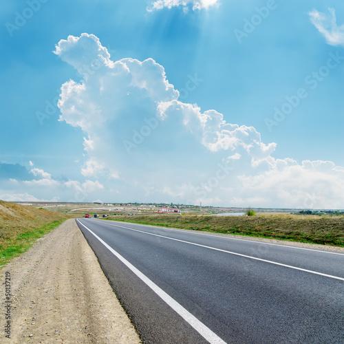 asphalt road to cloudy horizon