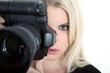 Fotografin mit Kamera, Frau blickt cool durch Sucher