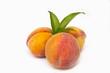 three peaches on a white background